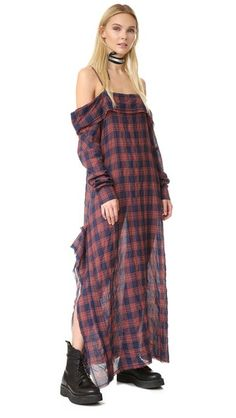 A raw, asymmetrical hem adds a grunge edge to this slouchy plaid R13 off-shoulder dress. Long sleeves and button cuffs. Adjustable straps. Unlined.