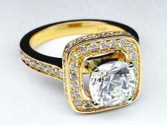 3.50ct diamond center sorounded by diamonds and round the ring
