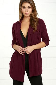 Call on The Marled Burgundy Hooded Cardigan Sweater for all those crisp days outdoors! Marled burgundy knit creates soft, long sleeves and an open front, complete with front pockets, and an oversized hood with drawstring.