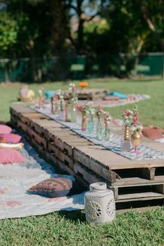 rustic bohemian outdoor wooden pallet wedding table / http://www.himisspuff.com/rustic-wood-pallet-wedding-ideas/5/