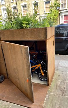 Beautiful, secure steel bike shed for bikes, bins, buggies with garden Bike Storage Front Garden, Outside Bike Storage, Outdoor Bicycle Storage, Bicycle Storage Shed, Bike Shed, Bike Storage Underground, Shed Design, Garage Design, Bike Storage Solutions