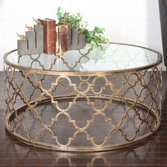 With its geometric base and antiqued silver leaf finish, this chic end table looks lovely displaying a stack of design books or an elegant lamp. Brass Coffee Table, Coffee Table Styling, Coffee Table Wayfair, Cool Coffee Tables, Round Coffee Table, Decorating Coffee Tables, Coffee Table Design, Bedside Table Lamps, Center Table