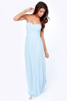 """Lulus Exclusive! The Slow Dance Strapless Light Blue Maxi Dress is playing your song, so slow it down and snuggle up to your sweetie in this gorgeous chiffon confection. Crisscrossing panels drape across a strapless sweetheart bodice, creating a figure-flattering, ruched silhouette, with a cinched and gathered waist that flows into a stunning floor-length maxi skirt. Padded bust and elastic across the back form a flattering fit. Hidden back zipper. Fully lined. Model is 5'10"""" and is ..."""