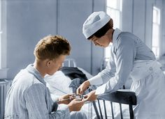 """Shorpy Historical Photo Archive: """"String Therapy"""". Nurse and patient at Walter Reed Army Hospital in Washington, D.C.  (Colorized Photo). 1918."""