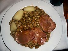 national dish in Luxembourg is Judd Mat Gaardebounen, a smoked collar of pork served with broad beans