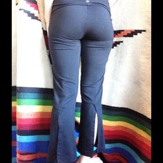 Prana Back Calve Slit Capris Black Stretchy Yoga Athletic yogi hippie. Fun slots up the back of the bottom leg. Good condition. Have been worn and washed. No stains or rips. Smoke free home. Made in USA. Jazz. Dance. Dancer. Zumba. Stretchy. Gym. Sport. Lounge. Pajama bottom. Flap to stretch over at top waist. Legging. Flare. prAna Pants Capris