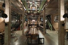 Image 1 of 31 from gallery of Industrial Brewery Pub In Saigon / T3 Architecture Asia. Photograph by Brice Godard