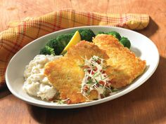 Parmesan Crusted Chicken - Topped with lemon Chardonnay butter sauce, sun-dried tomatoes, fresh basil and Parmesan cheese. Served with white cheddar mashed potatoes and steamed broccoli.