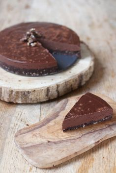 Rich, creamy and decadent Double Chocolate Truffle Tart. It's also vegan, gluten free and sweetened with dates + maple syrup!