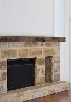 Stone Fireplace with Reclaimed Beam Large reclaimed sandstone blocks were used on the fireplace. These were salvaged from the previous home that was demolished A large recycled timber piece was used for the mantel Sandstone Fireplace, Wooden Fireplace, Farmhouse Fireplace, Fireplace Wall, Fireplace Surrounds, Glass Brick, Brick And Stone, Concrete Stone, Coastal Farmhouse