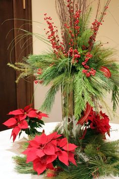 Last week, I had the privilege of doing some centerpieces for a corporate party of It was held at the Historic Coleman Theatre in Miami . Christmas Party Centerpieces, Christmas Decorations, Holiday Decor, Christmas Planters, Christmas Wreaths, Christmas Ideas, Winter Planter, Winter Theme, Holiday Parties