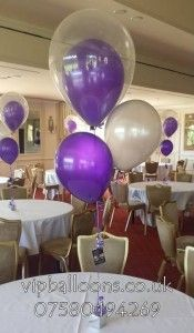 Prom table balloons in purple and silver
