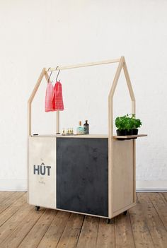 HÛT creates mobile plywood gin trolley to serve its architecture office