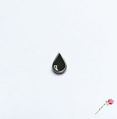 Black Teardrop Pin by Inner Decay.