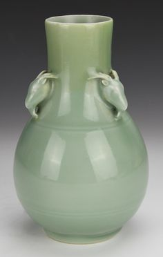 China, 18th C., very rare celadon vase with three ram's head ears at the neck, Yongzheng six-character mark on base within double circle, with silk box, professional restoration on neck. Length 8 7/8 in, Width 4 3/4 in