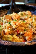 Seafood Paella Recipe  : <p>Paella is a traditional Spanish dish that is an easy one-pot meal. This healthy recipe for flavorful seafood paella replaces high fat pork sausage with low fat chicken sausage and shrimp.</p>