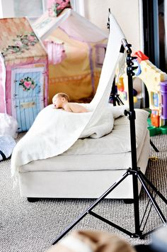behind the scenes of newborn photography shoot