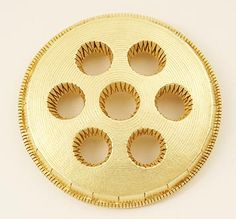 Gold Brooch by Lisa Gralnick. She was one of the first jewelers to think like a contemporary sculptor. (1988) -TR