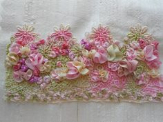 I ❤ ribbonwork . . . Soft and Romantic- This week I had a request through my services ad on Trade Me for some soft pink velvet flowers as well as some hand dyed silk ribbons in soft pinks, green & cream for a project she had in mind. Colours after my own heart, I thought, so whilst dyeing some ribbons for her I dyed some for myself. With my own hand dyed silk ribbon in lovely, soft colours I set about making another of my 'one of a kind' embroidery pieces and am very happy with the result.