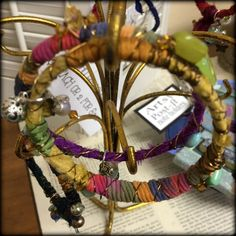 Gypsy Bangles.  Re-cycled bracelets with fibers and silks, accented with crystals and charms.