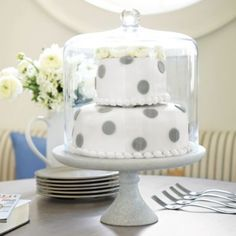 This is the dome that matches the cake plate (sold separately) - love this!  Most cake domes are too short and a decorated cake barely fits under it without the dome sitting atop the frosting/decorations!  ---Three Layer Cake Dome | Ballard Designs