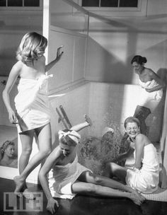 Six Hollywood fashion models from the Dorothy Preble Model Agency frolicking in the salutary waters of hot mineral baths at Arrowhead Hot Springs Hotel, 1948 by Peter Stackpole