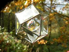clear beveled stained glass geometric sun by ravenglassgirl