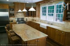 The featured granite is Golden Beach and it compliments the spacious design of this warm kitchen.