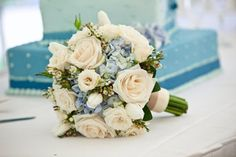 I really like the simplicity and subtlety of this bouquet BB0563-Vintage Ivory Rose and Blue Hydrangea Bridal Bouquet