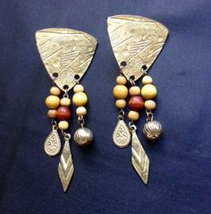 A personal favorite from my Etsy shop https://www.etsy.com/listing/253975022/vintage-goldtone-and-wood-bead-dangle
