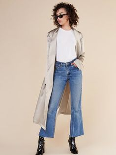 The lady and the trench.  This is a calf length trench coat with a shawl collar and detached belt.