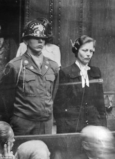 Trial: Dr Herta Oberheuser from Stocksee North West Germany is flanked by a US guard on trial for war crimes at Ravensbruck concentration camp in February 1958