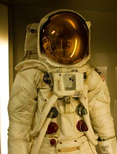 Apollo Astronaut suit with gold visor on display