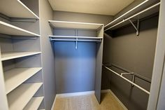 3 Rods with a full wall of shelving to maximize storage in this closet