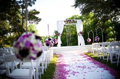 Purple petal covered wedding aisle...love