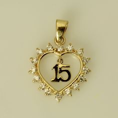 """14K Real Yellow Gold Sweet 15 Anos Quinceanera Heart Small Charm Pendant Cubic Zirconia 14 mm ( 9/16"""" ) Beautifully crafted in 14 karat real gold, this item is sure to catch the eye of any who can appreciate its beauty. The innovative design displayed in our 14K Gold Pendant makes it an instant hit. Perfect for the person who appreciates elegance and who wants to express their feelings of love to their significant other. Order this today or browse our incredible selection of fine gold…"""