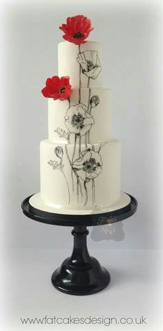 3 tier round cakes, black and white hand painted poppies with sugar flowers