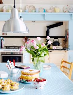 1950s kitchen with stainless steel pendant lights and summer fruit cake