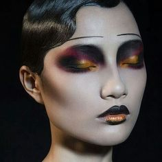 love the color scheme and the high, thin drawn on eyebrows. could fit for a doll or mime like character