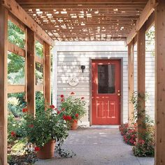 Attaching a pergola above a home's entryway adds practical protection from the elements for homeowners and visitors. This pergola shades the back door of a house and provides a cool place to relax on hot, sunny days.