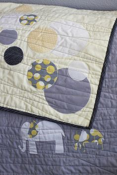 This is cute modern baby quilt, but I'll probably be substituting the elephant with turtles.