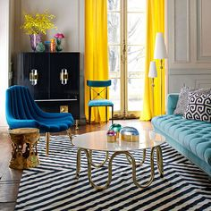 How to Rock Modern American Glamour Interior design geometric rugs Jonathan Adler colourful living room luxury homes brass coffee table lucite geometric rugs Slim Aarons wall prints Hollywood decor Palm beach chic Well if you love colour there'