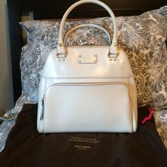 Kate Spade Porcelain Cream Wellesley Maeda Bag The bag is in used condition.  It has scuff marks shown in the pictures.  Other than that, the bag is in great shape.  Inside is clean w/ some stains at the bottom.  No issues w/ the handles or pocket in front.  Zippers work great.  Comes w/ dust bag.  Price reflects used condition. kate spade Bags