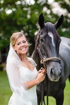 Beautiful Saratoga bride with a thoroughbred race horse at Saratoga Race Track in Saratoga Springs, NY