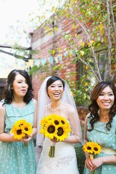 Aqua and Sunflower Wedding and I love the bridesmaids dresses!!
