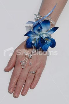 Silk Blooms Minnie galaxy blue wrist corsage. View here: http://www.silkblooms.co.uk/modern-galaxy-blue-orchid-satin-mini-rose-wedding-wrist-corsage-p-7233.html?cPath=1_23