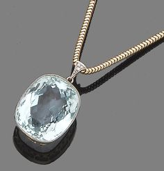 An aquamarine and diamond pendant necklace.  The oval mixed-cut aquamarine, to a single-cut diamond suspensory hoop, pendant length 2.9cm., chain length 43.0cm.