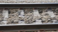 Close view of railroad track at high speed  - HD stock video clip
