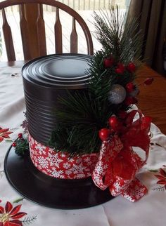 Snowman Hat Centerpieces Made from Dollar Store Plates and Large Tin Cans.