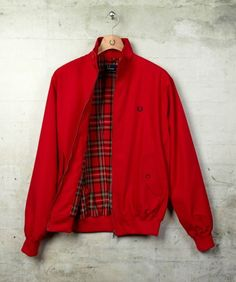 The brand founded by triple Wimbledon champion Fred Perry in 1952 and adopted by generations of British subcultures ever since. Skinhead Fashion, Skinhead Style, Fred Perry Harrington Jacket, Mod Fashion, Warm Sweaters, Vest Jacket, Menswear, Men Casual, Northern Soul